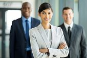 image of leader  - beautiful female business leader with team standing on background - JPG