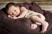 image of sleepy  - portrait of a cute sleepy newborn on a brown blanket - JPG