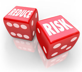 picture of hazardous  - Reduce Risk words on two red dice to illustrate lowering your chances for liability - JPG