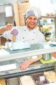 picture of confectioners  - Confectioner selling ice cream in the pastry shop - JPG