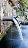 picture of groundwater  - Source of three pipes with crystal clear water of the mountain - JPG