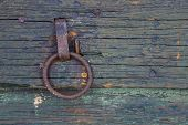 pic of outhouses  - Rusty ring pull on shed door with weathered wood texture visible - JPG