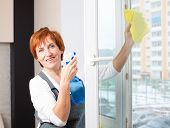 picture of window washing  - Mature woman cleaning window - JPG