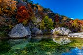 picture of crystal clear  - Beautiful Fall Foliage Surrounding Crystal Clear Pool with Blue Skies at Lost Maples State Park Texas - JPG