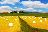 stock photo of haystacks  - Rural pastoral after harvesting - JPG
