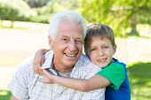 picture of grandfather  - Happy grandfather with his grandson on a sunny day - JPG
