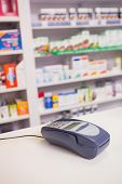 image of keypad  - Close up of a keypad on the counter in the pharmacy - JPG