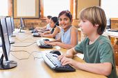 picture of pupils  - Cute pupils in computer class at the elementary school - JPG