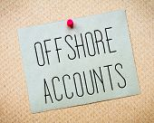 stock photo of offshore  - Recycled paper note pinned on cork board - JPG