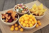 stock photo of junk food  - Savory snack party food selection in wooden bowls - JPG
