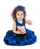 foto of dreidel  - cute little girl sitting on the floor and holding a dreidel  - JPG