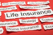 stock photo of insurance-policy  - Life Insurance Text On Piece Of Paper Salient Among Other Related Keywords - JPG