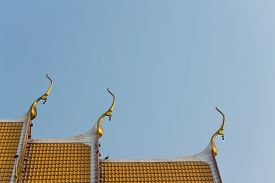 stock photo of apex  - the gable apex with small bell on the roof of temple - JPG