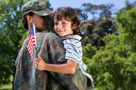 image of reunited  - Soldier reunited with her son on a sunny day - JPG