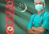 picture of turkmenistan  - Surgeon with flag on background  - JPG