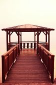pic of pier a lake  - Capture of Pier on Garda lake with beautiful view - JPG