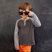 pic of peer  - Portrait of happy little boy wearing sunglasses smiling at camera - JPG