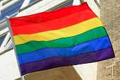 pic of gay symbol  - Rainbow flag flying which is a symbol of homosexual gay pride - JPG