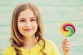foto of lollipops  - Cheerful young girl with a lollipop - JPG