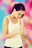 image of pregnancy test  - Worried woman with positive pregnancy test - JPG