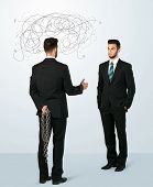 foto of backstabbers  - Ruthless businessman hiding a weapon and weaving plan around his head  - JPG
