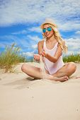 stock photo of funky  - Beach woman funky happy and colorful wearing sunglasses and beach hat having summer fun during travel holidays vacation - JPG