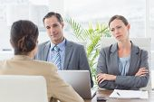 picture of conduction  - Business people conducting an interview in an office - JPG