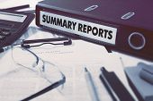 pic of summary  - Ring Binder with inscription Summary Reports on Background of Working Table with Office Supplies - JPG