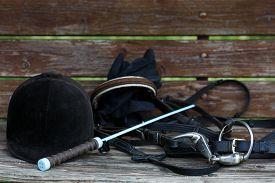 stock photo of scourge  - Attributes hobby horse rider on the wooden table - JPG