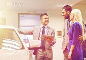 auto business, car sale, technology and people concept - happy couple with car dealer in auto show o poster