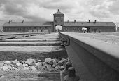 foto of auschwitz  - Railway line running under the famous arched entrance to the Auschwitz II  - JPG