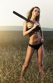 Young sexy woman with bat.
