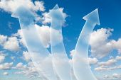 three transparent arrows on White, fluffy clouds in blue sky collage poster