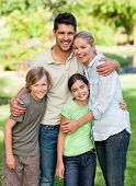 pic of happy family  - Happy family in the park - JPG