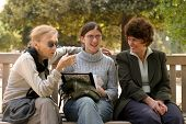 pic of mother daughter  - Grandmother and her doughter and granddoughter talking outside - JPG