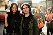 stock photo of young adult  - Young couple together on a street - JPG