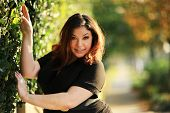 stock photo of plus size model  - Beautiful plus size model outdoors - JPG