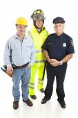 Group of blue collar workers, construction worker, policeman, and fireman, isolated on white.