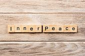 Inner Peace Word Written On Wood Block. Inner Peace Text On Table, Concept. poster