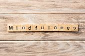 Mindfulness Word Written On Wood Block. Mindfulness Text On Table, Concept. poster