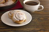 Fresh Baked Cinnamon Rolls Ready For Breakfast With A Cup Of Coffee poster