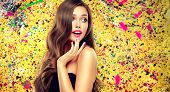 Woman Surprise Showing Product .beautiful Girl With Curly Hair Pointing To The Side . Presenting You poster