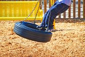 image of tire swing  - Boy on Tire Swing - JPG