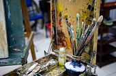 Easel With Tools In The Studio Of Painting poster