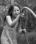 stock photo of hula hoop  - Freckle Faced Girl Focusing with One Eye Closed Making Cute Wink - JPG