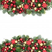 Christmas decorative background border with red and gold bauble decorations, holly berries, spruce p poster