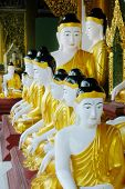 stock photo of samadhi  - close up of budda statues in buddist temple - JPG
