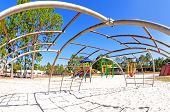 image of swingset  - Wide angle view fron underneath jungle gym - JPG