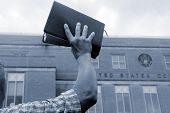 image of zealots  - Man holding up bible in front of court house - JPG