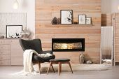 Cozy Living Room Interior With Comfortable Furniture And Decorative Fireplace poster